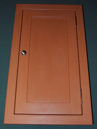 narrow medicine cabinet in pumpkin with paneled door