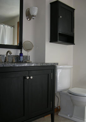 "36"" black shaker style vanity with a granite top"