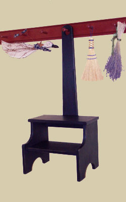 step stool hanging on peg rack