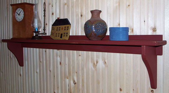 Wall shelf in destressed barn red